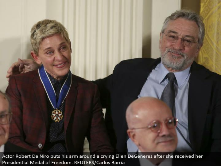 Actor Robert De Niro puts his arm around a crying Ellen DeGeneres after she got her Presidential Medal of Freedom. REUTERS/Carlos Barria