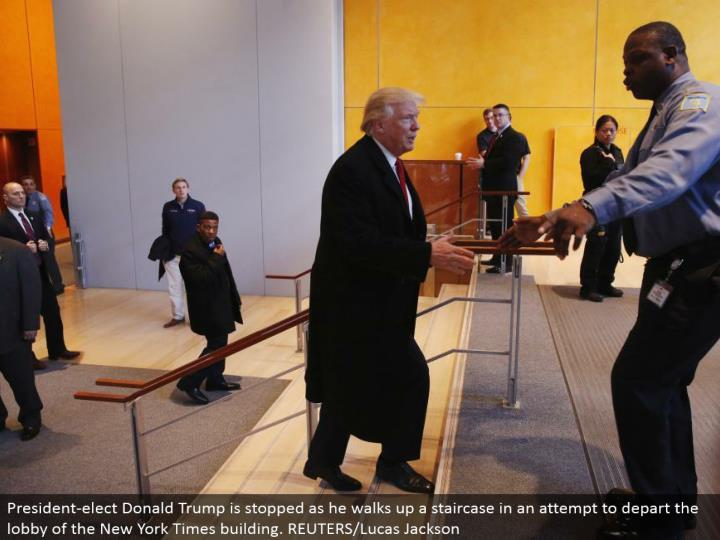 President-choose Donald Trump is halted as he strolls up a staircase trying to withdraw the hall of the New York Times building. REUTERS/Lucas Jackson