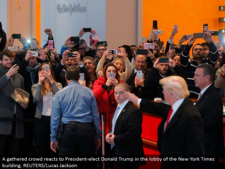 A assembled swarm responds to President-elect Donald Trump in the anteroom of the New York Times building. REUTERS/Lucas Jackson