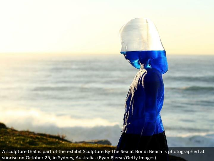 A mold that is a piece of the show Sculpture By The Sea at Bondi Beach is captured at dawn on Octobe...