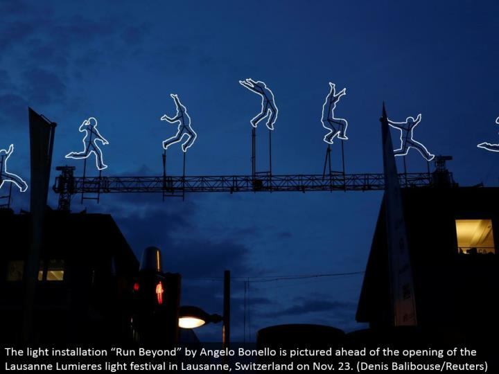 "The light establishment ""Keep running Beyond"" by Angelo Bonello is envisioned in front of the opening of the Lausanne Lumieres light celebration in Lausanne, Switzerland on Nov. 23. (Denis Balibouse/Reuters)"