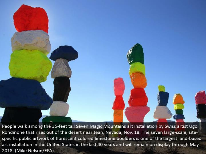 People stroll among the 35-feet tall Seven Magic Mountains craftsmanship establishment by Swiss craftsman Ugo Rondinone that ascents out of the abandon close Jean, Nevada, Nov. 18. The seven substantial scale, site-particular open fine art of colorific shaded limestone stones is one of the biggest land-based workmanship establishment in the United States in the most recent 40 years and will stay in plain view through May 2018. (Mike Nelson/EPA)