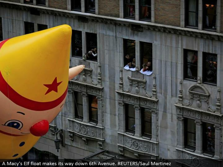 A Macy's Elf glide advances down sixth Avenue. REUTERS/Saul Martinez