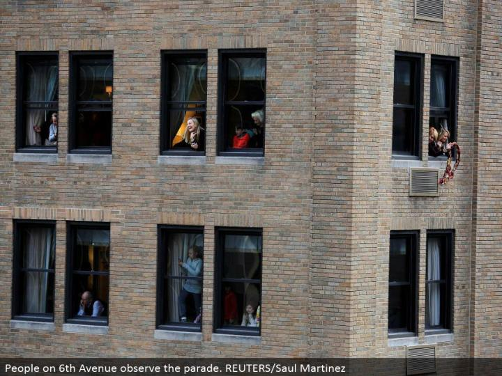 People on sixth Avenue watch the parade. REUTERS/Saul Martinez