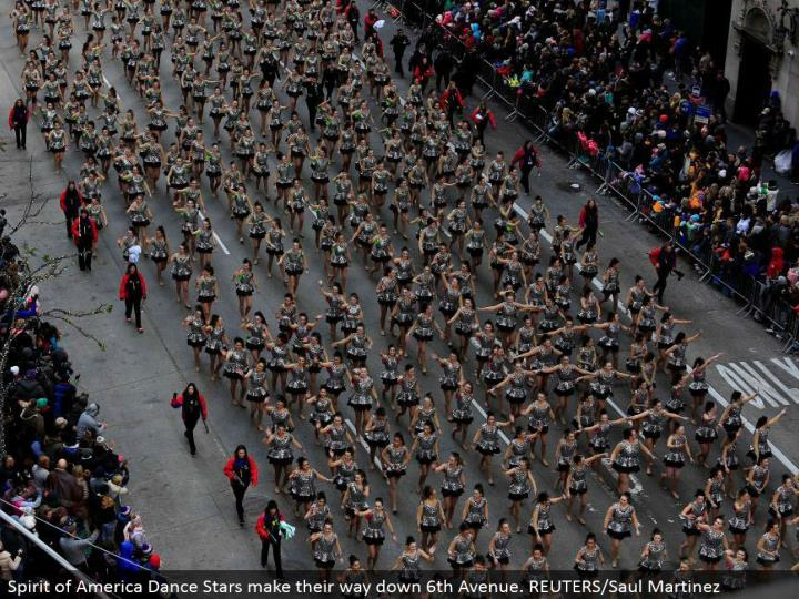 Spirit of America Dance Stars advance down sixth Avenue. REUTERS/Saul Martinez