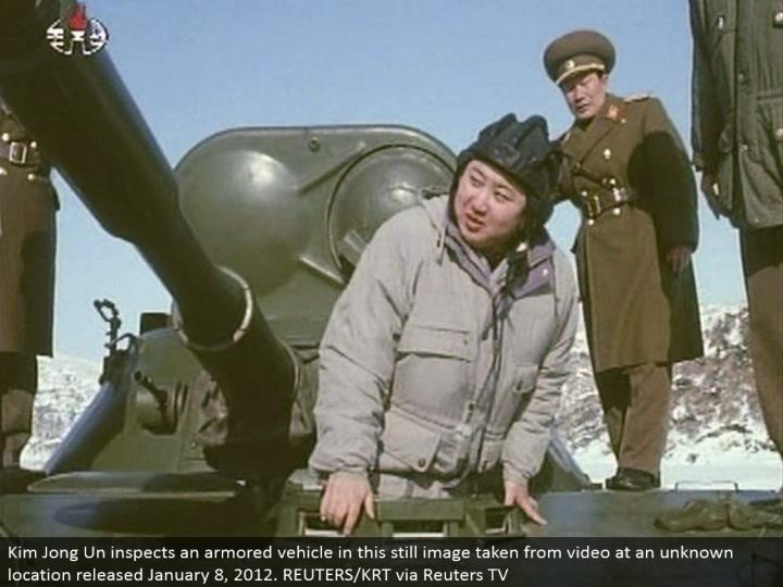 Kim Jong Un reviews a heavily clad vehicle in this still picture taken from video at an obscure area discharged January 8, 2012. REUTERS/KRT by means of Reuters TV