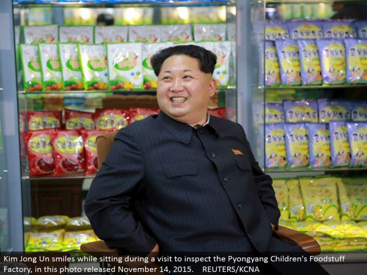 Kim Jong Un grins while sitting amid a visit to review the Pyongyang Children's Foodstuff Factory, in this photograph discharged November 14, 2015. REUTERS/KCNA