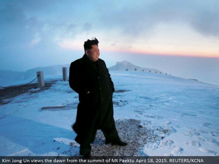 Kim Jong Un sees the first light from the summit of Mt Paektu April 18, 2015. REUTERS/KCNA