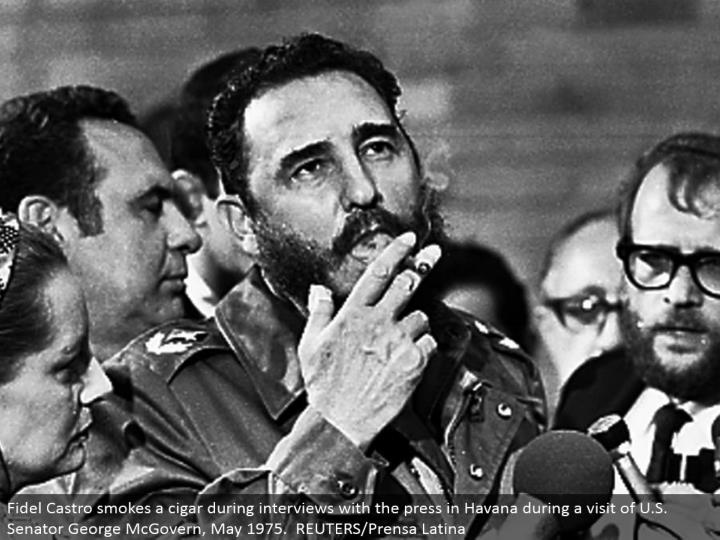 Fidel Castro smokes a stogie amid meetings with the press in Havana amid a visit of U.S. Congressperson George McGovern, May 1975. REUTERS/Prensa Latina