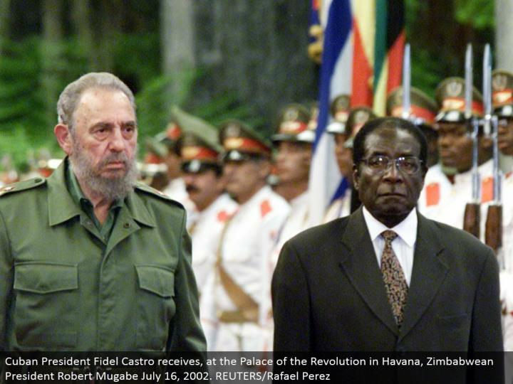 Cuban President Fidel Castro gets, at the Palace of the Revolution in Havana, Zimbabwean President Robert Mugabe July 16, 2002. REUTERS/Rafael Perez
