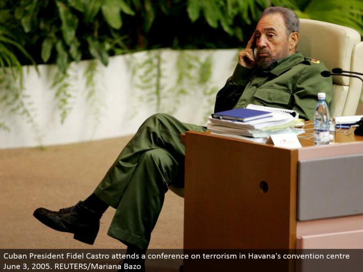 Cuban President Fidel Castro goes to a meeting on psychological warfare in Havana's tradition focus June 3, 2005. REUTERS/Mariana Bazo