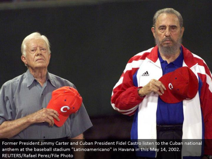 Former President Jimmy Carter and Cuban President Fidel Castro listen to the Cuban national song of ...