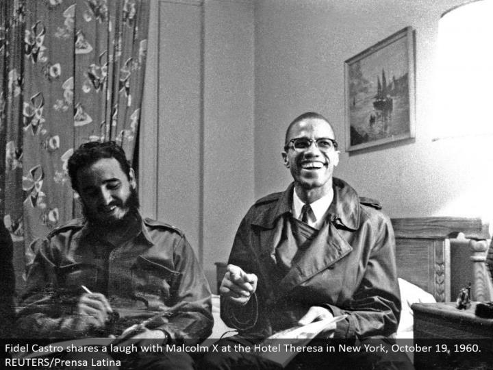 Fidel Castro imparts a giggle to Malcolm X at the Hotel Theresa in New York, October 19, 1960. REUTERS/Prensa Latina