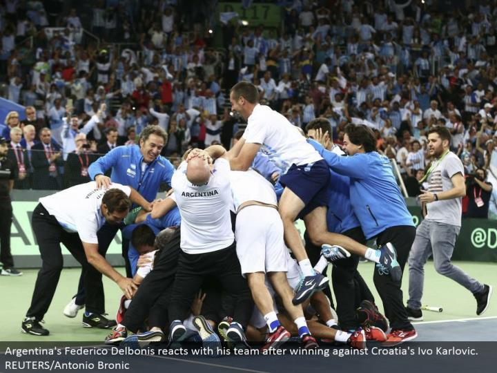 Argentina's Federico Delbonis responds with his group in the wake of winning against Croatia's Ivo Karlovic. REUTERS/Antonio Bronic