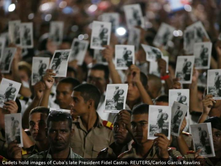 Cadets hold pictures of Cuba's late President Fidel Castro. REUTERS/Carlos Garcia Rawlins