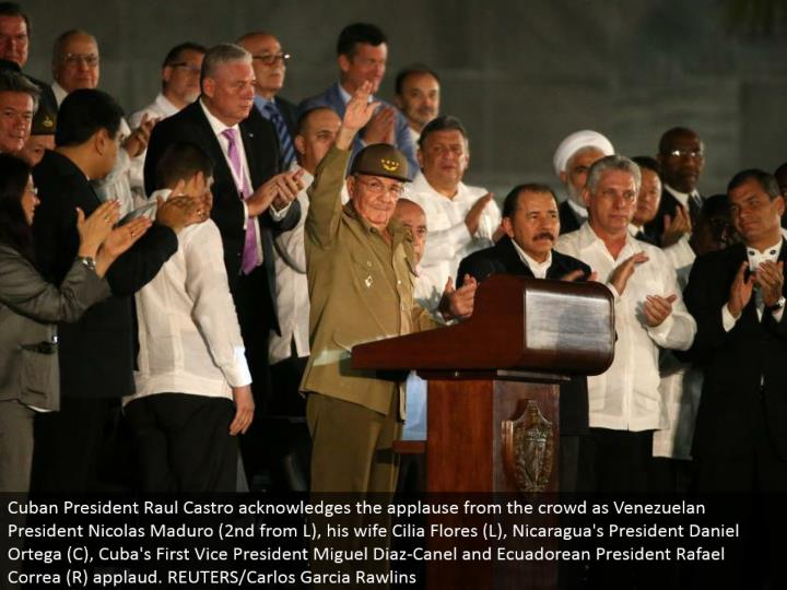 Cuban President Raul Castro recognizes the acclaim from the group as Venezuelan President Nicolas Maduro (second from L), his significant other Cilia Flores (L), Nicaragua's President Daniel Ortega (C), Cuba's First Vice President Miguel Diaz-Canel and Ecuadorean President Rafael Correa (R) cheer. REUTERS/Carlos Garcia Rawlins