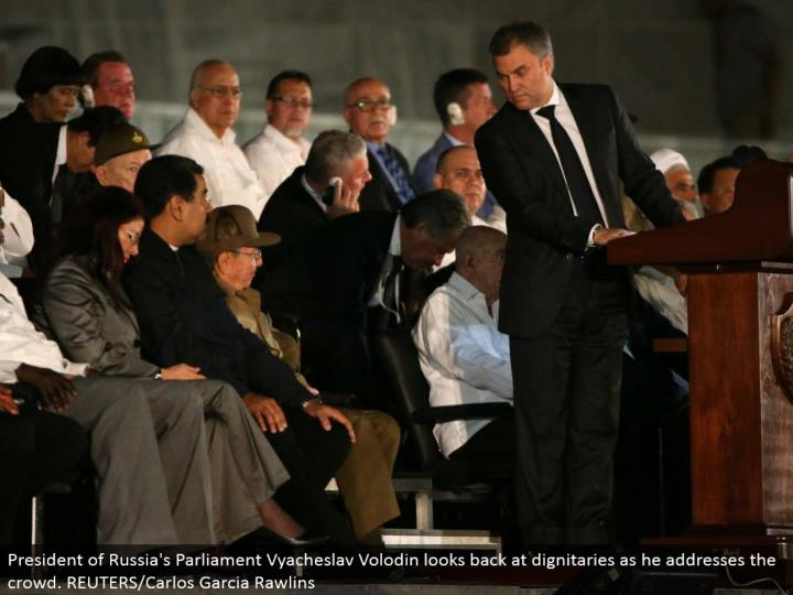 President of Russia's Parliament Vyacheslav Volodin glances back at dignitaries as he addresses the group. REUTERS/Carlos Garcia Rawlins
