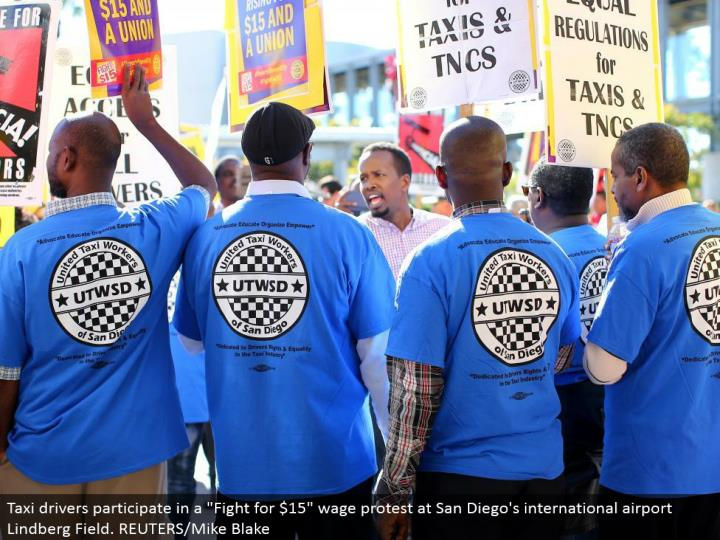 "Taxi drivers take an interest in a ""Battle for $15"" wage dissent at San Diego's universal air terminal Lindberg Field. REUTERS/Mike Blake"