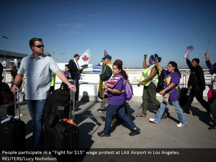 "People partake in a ""Battle for $15"" wage challenge at LAX Airport in Los Angeles.  REUTERS/Lucy Nicholson"