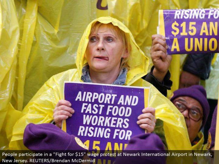 "People take an interest in a ""Battle for $15"" wage dissent at Newark International Airport in Newark..."