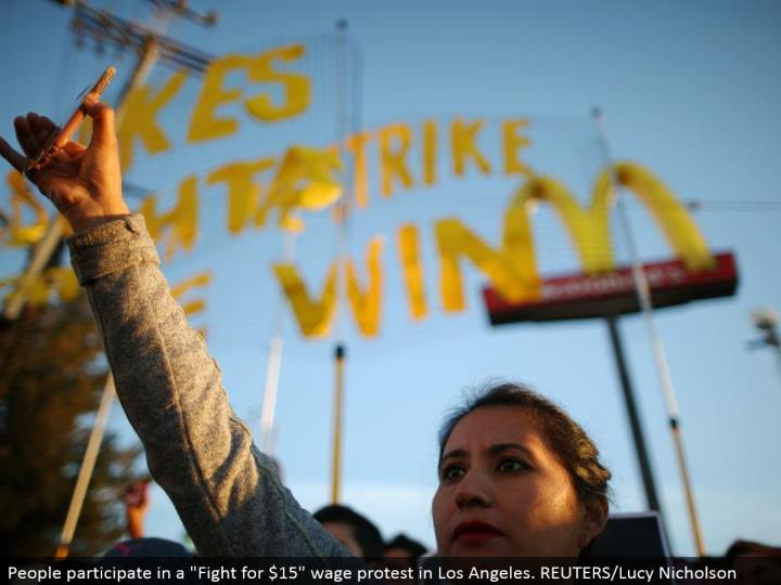 "People take an interest in a ""Battle for $15"" wage dissent in Los Angeles. REUTERS/Lucy Nicholson"