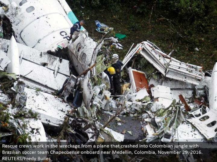 Rescue groups work in the destruction from a plane that collided with Colombian wilderness with Brazilian soccer group Chapecoense locally available close Medellin, Colombia, November 29, 2016. REUTERS/Fredy Builes