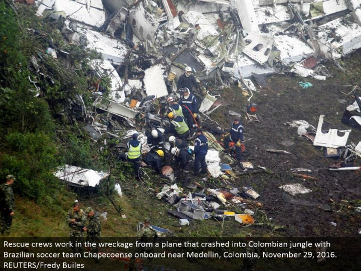 Rescue groups work in the destruction from a plane that collided with Colombian wilderness with Brazilian soccer group Chapecoense installed close Medellin, Colombia, November 29, 2016. REUTERS/Fredy Builes