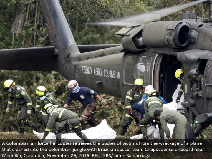 A Colombian aviation based armed forces helicopter recovers the assortments of casualties from the destruction of a plane that collided with the Colombian wilderness with Brazilian soccer group Chapecoense locally available close Medellin, Colombia, November 29, 2016. REUTERS/Jaime Saldarriaga