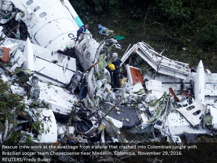Rescue group work at the destruction from a plane that collided with Colombian wilderness with Brazilian soccer group Chapecoense close Medellin, Colombia, November 29, 2016. REUTERS/Fredy Builes