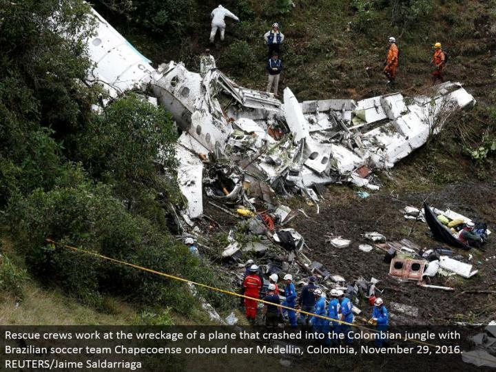 Rescue groups work at the destruction of a plane that collided with the Colombian wilderness with Brazilian soccer group Chapecoense locally available close Medellin, Colombia, November 29, 2016. REUTERS/Jaime Saldarriaga