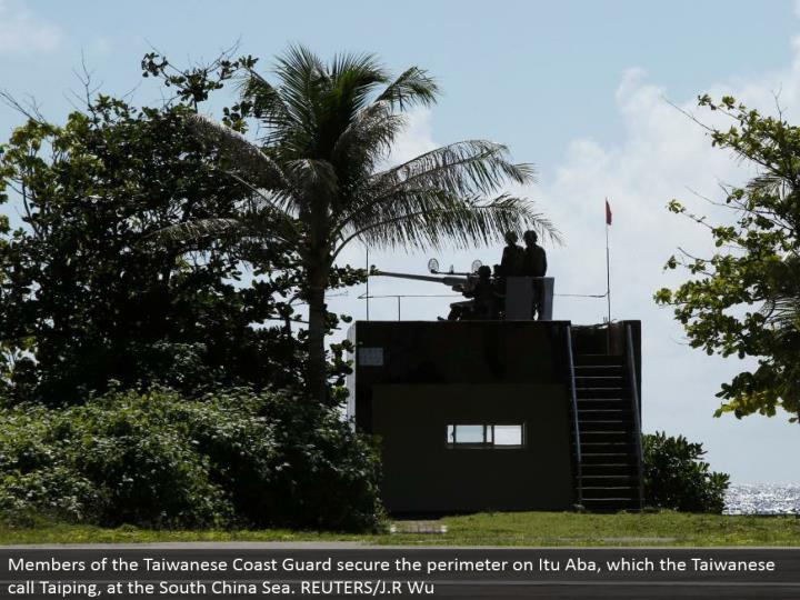 Members of the Taiwanese Coast Guard secure the border on Itu Aba, which the Taiwanese call Taiping,...