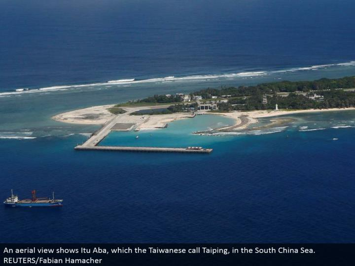 An airborne view indicates Itu Aba, which the Taiwanese call Taiping, in the South China Sea. REUTERS/Fabian Hamacher