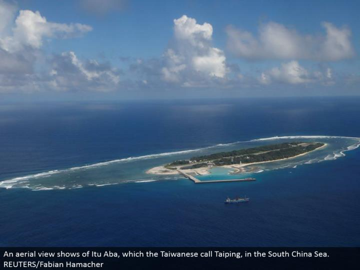 An flying perspective shows of Itu Aba, which the Taiwanese call Taiping, in the South China Sea.  REUTERS/Fabian Hamacher