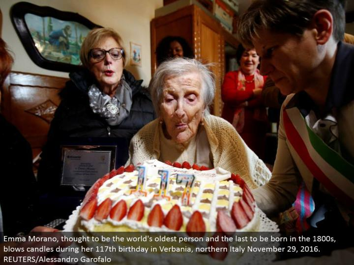 Emma Morano, thought to be the world's most established individual and the last to be conceived in the 1800s, blows candles amid her 117th birthday in Verbania, northern Italy November 29, 2016. REUTERS/Alessandro Garofalo