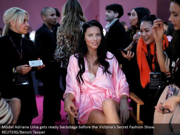 Model Adriana Lima prepares backstage before the Victoria's Secret Fashion Show. REUTERS/Benoit Tessier
