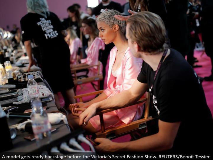A demonstrate prepares backstage before the Victoria's Secret Fashion Show. REUTERS/Benoit Tessier