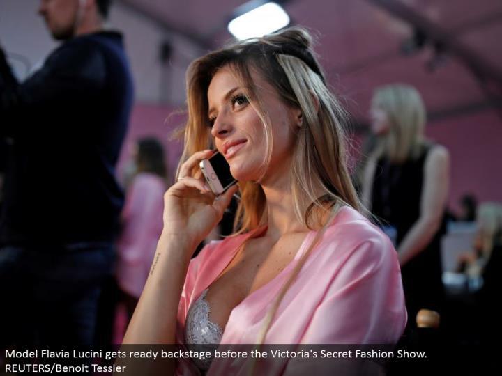 Model Flavia Lucini prepares backstage before the Victoria's Secret Fashion Show. REUTERS/Benoit Tessier