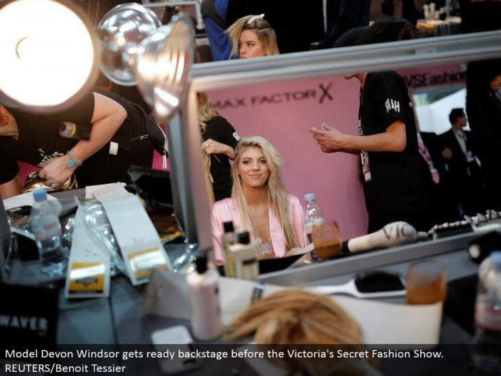 Model Devon Windsor prepares backstage before the Victoria's Secret Fashion Show. REUTERS/Benoit Tessier