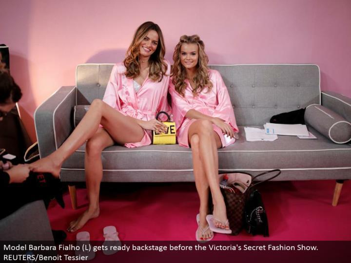 Model Barbara Fialho (L) prepares backstage before the Victoria's Secret Fashion Show. REUTERS/Benoit Tessier