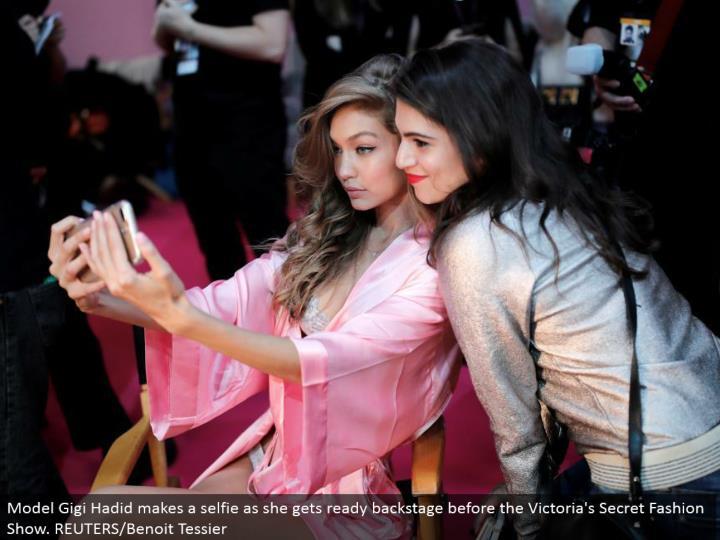 Model Gigi Hadid makes a selfie as she prepares backstage before the Victoria's Secret Fashion Show. REUTERS/Benoit Tessier