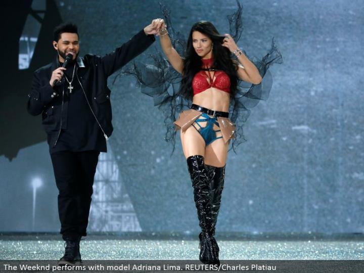 The Weeknd performs with model Adriana Lima. REUTERS/Charles Platiau