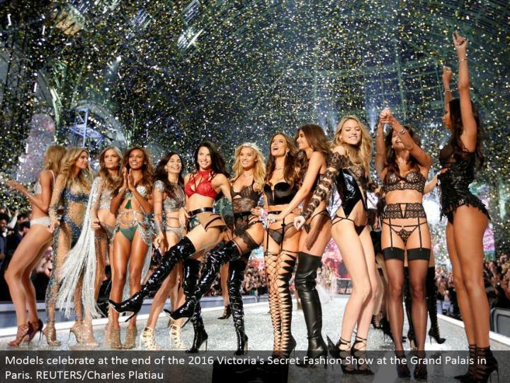Models celebrate toward the end of the 2016 Victoria's Secret Fashion Show at the Grand Palais in Pa...