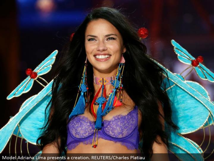 Model Adriana Lima shows a creation. REUTERS/Charles Platiau