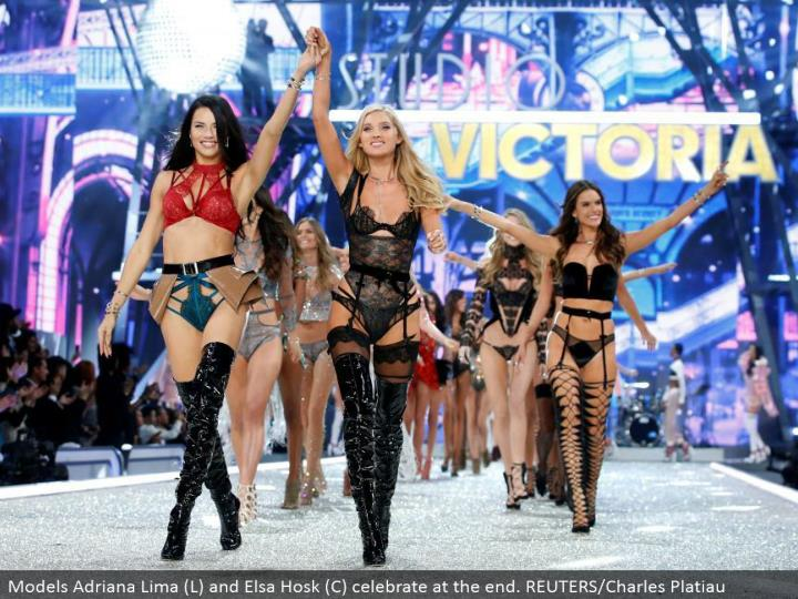 Models Adriana Lima (L) and Elsa Hosk (C) celebrate toward the end. REUTERS/Charles Platiau