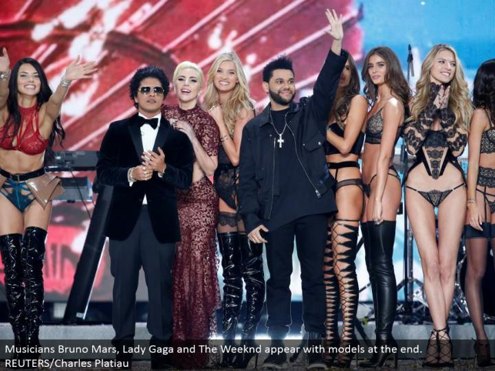 Musicians Bruno Mars, Lady Gaga and The Weeknd show up with models toward the end. REUTERS/Charles Platiau
