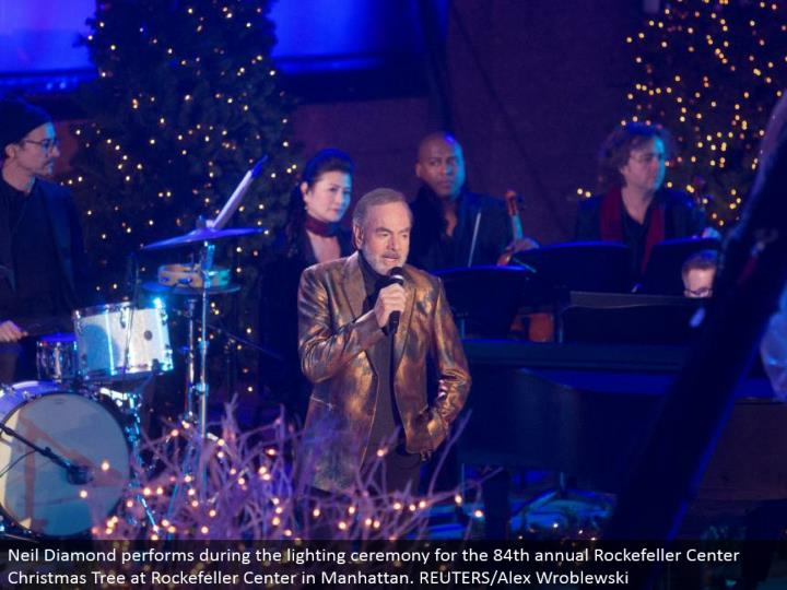 Neil Diamond performs amid the lighting function for the 84th yearly Rockefeller Center Christmas Tree at Rockefeller Center in Manhattan. REUTERS/Alex Wroblewski