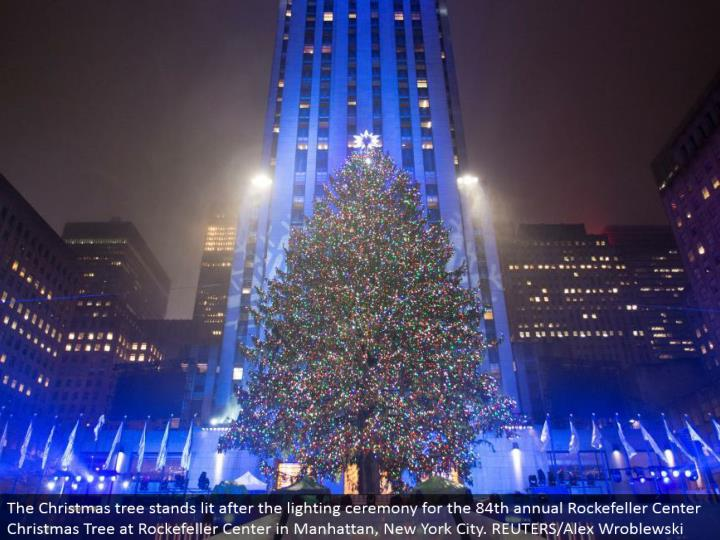 The Christmas tree stands lit after the lighting function for the 84th yearly Rockefeller Center Chr...