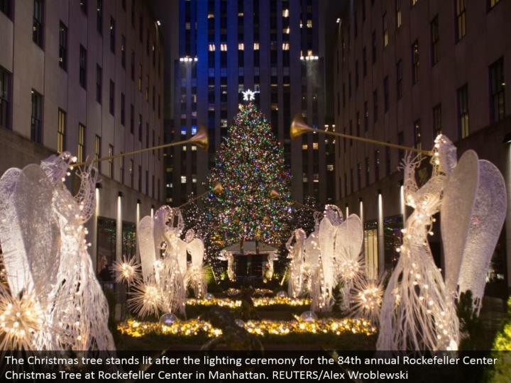 The Christmas tree stands lit after the lighting function for the 84th yearly Rockefeller Center Christmas Tree at Rockefeller Center in Manhattan. REUTERS/Alex Wroblewski