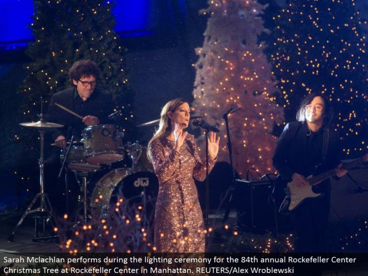 Sarah Mclachlan performs amid the lighting service for the 84th yearly Rockefeller Center Christmas Tree at Rockefeller Center in Manhattan. REUTERS/Alex Wroblewski