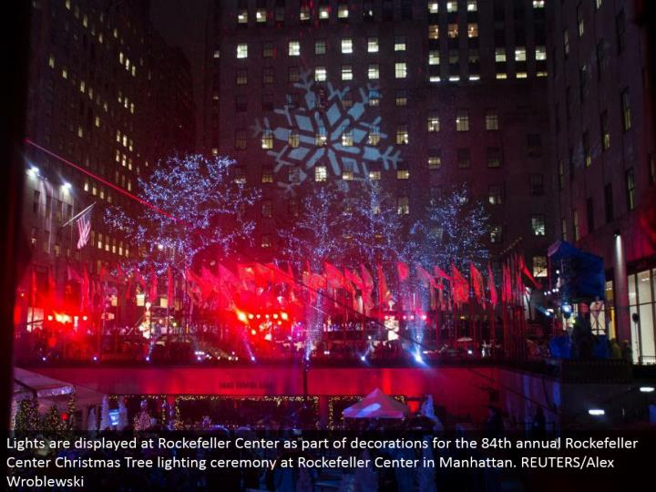 Lights are shown at Rockefeller Center as a component of enrichments for the 84th yearly Rockefeller Center Christmas Tree lighting service at Rockefeller Center in Manhattan. REUTERS/Alex Wroblewski